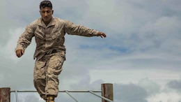 Cpl. Jacob Gomez, a rifleman with Bravo Company, 1st Battalion, 3rd Marine Regiment and a Lubbock, Texas native, walks across a log while running through the obstacle course at Boondocker Training Area aboard Marine Corps Base Hawaii, Sept. 15, 2015. Marines from Bravo Co. 1st Bn., 3rd Marines conducted sustainment training to ensure they keep their combat mindset sharp and intact before embarking on their upcoming Unit Deployment Program. Training like this supports the mission of Marine Corps Base Hawaii by enhancing and sustaining combat readiness.