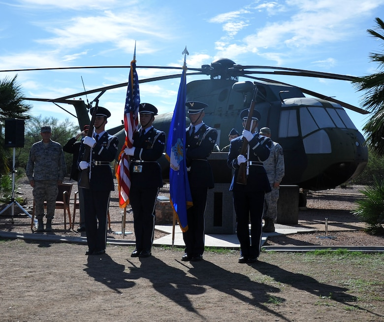 The Davis-Monthan Air Force Base Honor Guard prepare to posts the Colors at a memorial ceremony in honor of the 15 men who died in the crash of PONY 1-2 March 12, 1989. The ceremony was held at Heritage Park on Davis-Monthan AFB at Heritage Park in front of a static display of CH-3E Jolly Green Giant helicopter similar to the own flown by the aircrew of flight PONY 1-2. (U.S. Air Force Photo/ Tech. Sgt. Carolyn Herrick)