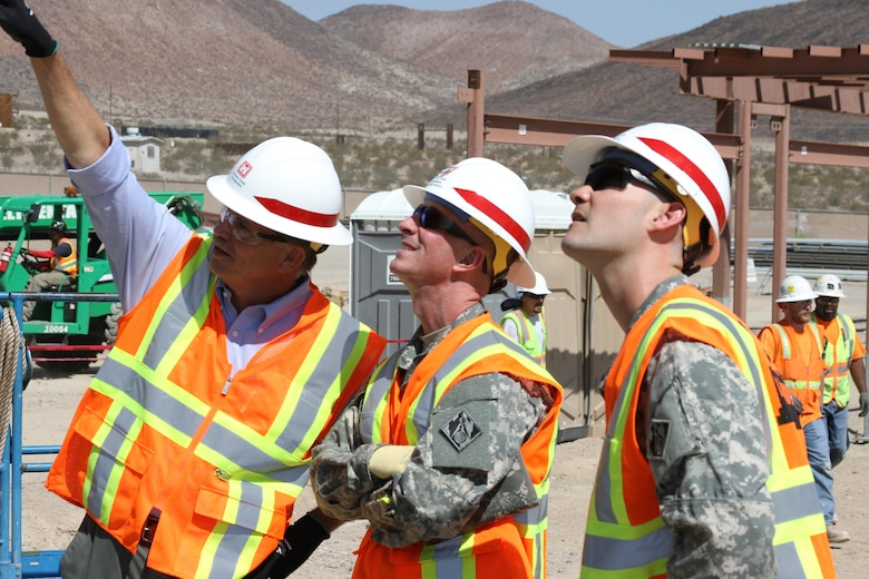 Col. Kirk Gibbs, U.S. Army Corps of Engineers Los Angeles District commander,John Keever, USACE Los Angeles District chief of construction, and Capt. Evan Nelson, project engineer discuss design features at the Weed Army Hospital replacement project site.  Gibbs, toured several District projects at the National Training Center at Fort Irwin, California, during a visit to the fort Sept. 9-10.