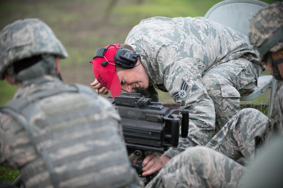 Senior Airman Jordan Thompson, a 168th Alaska Air National Guard combat arms training instructor, adjusts the aim of a Mark 19 grenade launcher Sept. 9, 2015, at Eielson Air Force Base, Alaska. Thompson was leading the training to qualify members of the 354th Security Forces Squadron on the weapon. (U.S. Air Force photo by Staff Sgt. Shawn Nickel/Released)