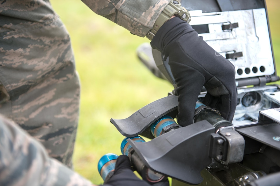 A response force member from the 354th Security Forces Squadron loads 40mm rounds into a Mark 19 grenade launcher Sept. 9, 2015, at Eielson Air Force Base, Alaska. The launcher was first developed in the Vietnam War and has been developed since to be more reliable in combat. (U.S. Air Force photo by Staff Sgt. Shawn Nickel/Released)