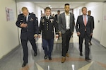 Defense Secretary Ash Carter, right, escorts Air Force Airman 1st Class Spencer Stone, left, Oregon National Guard Specialist Alek Skarlatos, second from left, and civilian Anthony Sadler to an awards ceremony in the Pentagon's courtyard held in their honor for their heroic actions in stopping a gunman on a Paris-bound train outside of Brussels last month, Sept. 17, 2015. DoD Photo by Glenn Fawcett