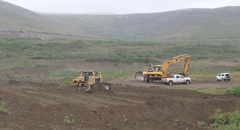 Heavy equipment prepares a landfarming cell near the Tank Site E project near Nome, Alaska. Landfarming is a potential solution to meet the needs of the U.S. Army Corps of Engineers – Alaska District's Formerly Used Defense Sites program across Alaska. The process includes removing contaminated soil from the source location, spreading it across an expansive area one to two feet thick, tilling consistently and then letting nature take control to degrade the pollutants.