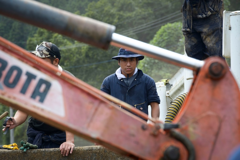 A 374th Civil Engineer Squadron fire protection member takes a break from digging mud during flood relief at Kanuma City, Tochigi prefecture, Japan, Sept. 15, 2015. More than 60 volunteers, Airmen and Japanese who work at Yokota Air Base, ventured to the prefecture to help local residents restore their properties. Ten days of rain led to mass flooding and many landslides that damaged personal and public property. (U.S. Air Force photo by Staff Sgt. Cody H. Ramirez/Released)