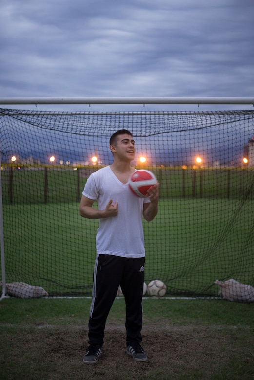 Airman 1st Class Tomasz Barba, volunteer soccer coach, handles a soccer ball at Yokota Air Base, Japan, Sept. 15, 2015. Barba said that he's benefited from coaching as it allowed him to revisit and reinforce his own fundamentals. (U.S. Air Force photo by Airman 1st Class Delano Scott/Released)