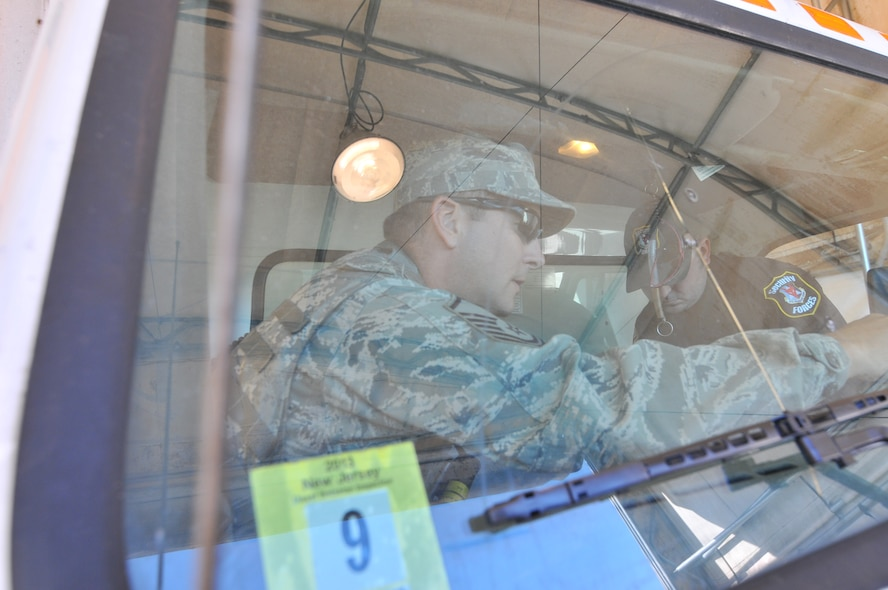 U.S. Air Force Master Sgt. Ryan Butcher, civil engineer, with the New Jersey Air National Guard's 177th Fighter Wing, and Andrew Constantine, civilian contractor, inspect a commercial vehicle entering the Atlantic City Air National Guard Base, Sept. 16, 2015. Butcher is serving as a security forces augmentee to assist the Wing's Security Forces Squadron's manning requirements. (U.S. Air National Guard photo by Senior Airman Amber Powell/Released)