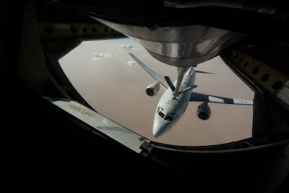 A Royal Australian Air Force E-7A Wedgetail receives fuel from an Air National Guard KC-135 Stratotanker that is deployed to the 340th Expeditionary Air Refueling Squadron at Al Udeid Air Base, Qatar over Iraq September 16, 2015. (U.S. Air Force photo/Staff Sgt. Alexandre Montes)