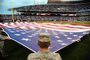 Airmen from Whiteman Air Force Base, Mo., perform a flag detail during Armed Forces Night at Kauffman Stadium in in Kansas City Sept. 8, 2015. The pregame ceremonies included recognition of veterans, wounded warriors and military families, as well as a tribute to fallen service members. (U.S. Air Force photo/Senior Airman Joel Pfiester)