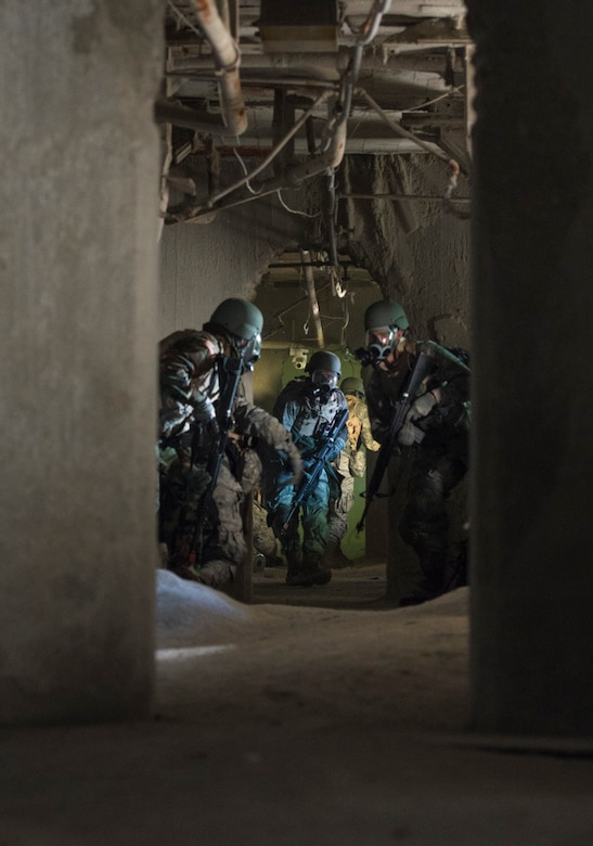 Participants in the Air Force Research Laboratory 2015 Tech Warrior work to exit an underground tunnel after a smoke grenade simulating mustard gas was released during their search for a weapons cache as part of a dismounted patrol scenario, Sept. 15, 2015, at the National Center for Medical Readiness, Fairborn, Ohio. During the exercise, participants learn a variety of skills such as base defense, self-aid and buddy care, and tactical vehicle driving and land navigation. (U.S. Air Force photo/Wesley Farnsworth)