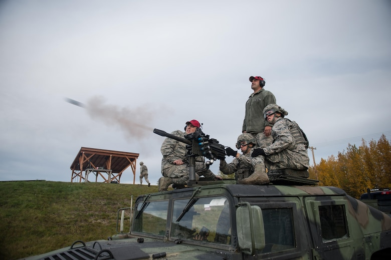 Airman Jeffery Gibson, a 354th Security Forces Squadron response force member, fires a Mark-19 grenade launcher Sept. 9, 2015, at Eielson Air Force Base, Alaska. Members of the squadron must show proficiency annually to be qualified on the weapon. (U.S. Air Force photo/Staff Sgt. Shawn Nickel)