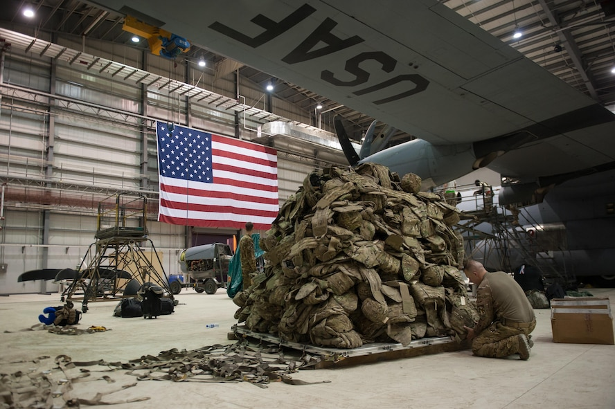 A U.S. Airman assigned to the 774th Expeditionary Airlift Squadron prepares a pallet before it is loaded onto a C-130J Super Hercules aircraft at Bagram Airfield, Afghanistan, Sept. 12, 2015. The Airman and his squadron were in the process of redeploying to Little Rock Air Force Base, Ark., after successfully completing their deployment. (U.S. Air Force photo/Tech. Sgt. Joseph Swafford)