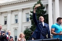 """Airman 1st Class Spencer Stone receives a ceremonial """"key to the city"""" from Mayor Kevin Johnson during the Sacramento Hometown Heroes Parade and festivities in Sacramento, Calif., Sept. 11, 2015. (U.S. Air Force photo/ Senior Airman Charles Rivezzo)"""
