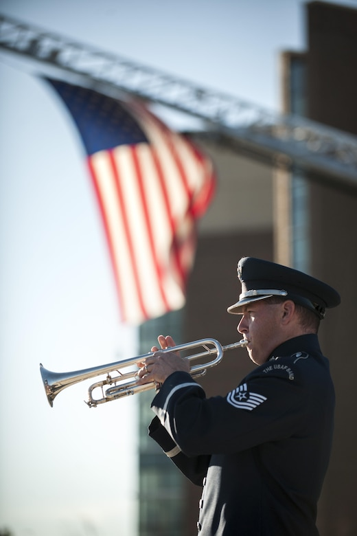 Tech. Sgt. Matthew Miser, a U.S. Air Force Band's Ceremonial Brass trumpeter, plays Taps during a Patriot's Day Reveille Ceremony at Heritage Park, Joint Base Andrews, Md., Sept. 11, 2015. The ceremony paid tribute to the first responders and victims of the terrorist attacks on Sept. 11, 2001. (U.S. Air Force photo/Airman 1st Class Philip Bryant)