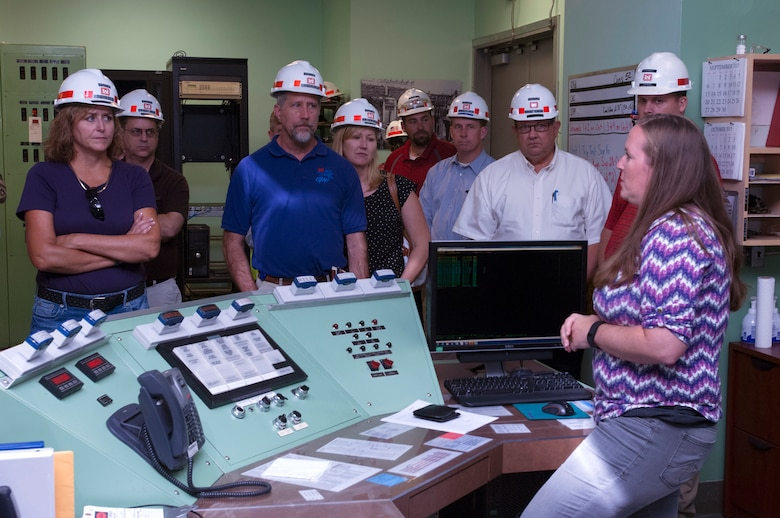 Amber Cole (Right), electrical engineer in the U.S. Army Corps of Engineers Nashville District's Electronic Service Section, answers technical questions with the members of Team Cumberland that were touring the Old Hickory Dam Power Plant in Hendersonville, Tenn., Sept. 15, 2015. (USACE photo by Leon Roberts)