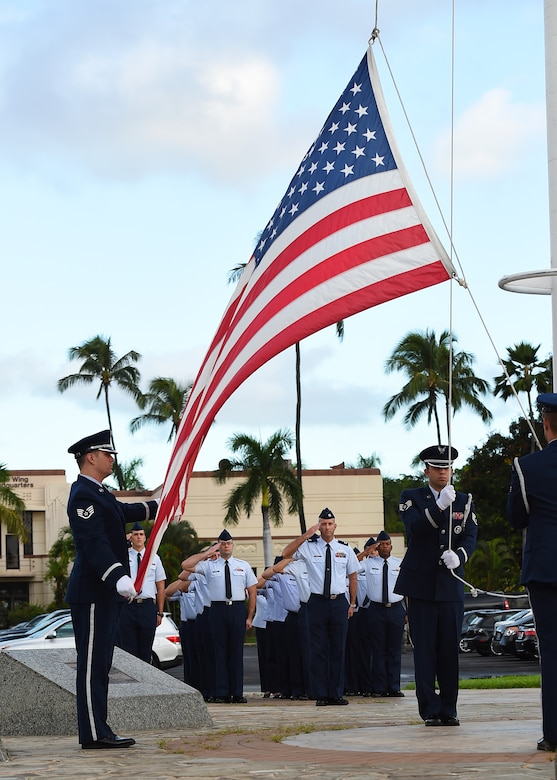 Airmen from Joint Base Pearl Harbor-Hickam's Air Force Sergeant's Association salute during a POW/MIA revile ceremony, on JBPHH, Hawaii, Sept. 14, 2015. The ceremony begins this year's POW/MIA week, which honors the 1,627 missing or unaccounted for military members  in all branches of armed  services. Some of the week's events will include name readings of those missing or unaccounted for, a remembrance run and a honors and heritage ceremony, held at the Pearl Harbor visitor's center.  (U.S. Air Force photo by Tech. Sgt. Aaron Oelrich/Released)