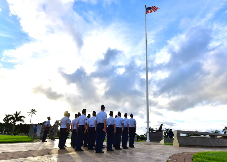 Airmen from the Joint Base Pearl Harbor-Hickam Air Force Sergeant's Association present arms during a POW/MIA revile ceremony, on JBPHH, Hawaii, Sept. 14, 2015. The ceremony kicks off this year's POW/MIA week, which honors the 1,627 missing or unaccounted for military members  in all branches of service. Some of the week's events will include name readings of those missing or unaccounted for, a remembrance run and a honors and heritage ceremony, held at the Pearl Harbor visitor's center.  (U.S. Air Force photo by Senior Airman Christopher Stoltz/Released)