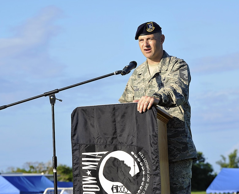 Guest speaker, U.S. Air Force Senior Master Sgt. Jamie Auger, 18th Security Forces Squadron security forces manager, gives opening remarks at Marek Park Sept. 17, 2015, on Kadena Air Base, Japan. Team Kadena honored and highlighted their commitment to prisoners of war and missing in action with a 24-hour vigil run. This event was also open to all Status of Forces Agreement members to honor the POW/MIA. (U.S. Air Force photo by Naoto Anazawa/Released)