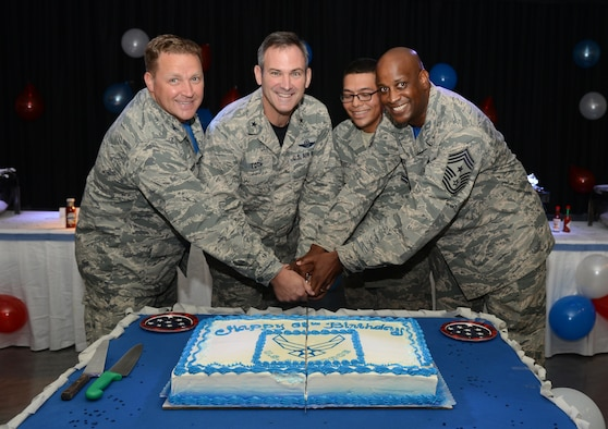 36th Wing leadership cut a cake with Airman 1st Class Mario Perez, 36th Force Support Squadron, during the 68th Air Force birthday celebration at the Top of the Rock dining facility Sept. 18, 2015, on Andersen Air Force Base, Guam. The birthday event celebrated the creation of the U.S. Air Force as an independent service in 1947, when the Air Force separated from the Army Air Forces. (U.S. Air Force photo by Airman 1st Class Arielle Vasquez/Released)
