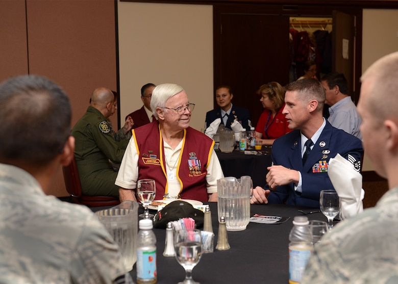 Retired U.S. Army Sgt. 1st Class Obie Wickersham (left), World War II veteran and Korean War POW, sits and speaks with Beale Airmen during a National POW/MIA Recognition Day event at Beale Air Force Base, California, Sept. 18, 2015. Wickersham was captive for 28 months after Chinese forces overran his platoon May 17, 1951. (U.S. Air Force photo by Chandresh Bhakta)