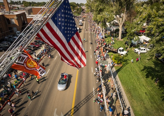 The American and Mountain Home Fire Department flags fly over the Air Force Appreciation Day Parade in Mountain Home, Idaho, Sept. 12, 2015. The parade, which honors the relationship between the Mountain Home community and nearby base, is the longest in Idaho. (U.S. Air Force photo by Tech. Sgt. Samuel Morse)