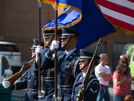 Mountain Home Air Force Base Honor Guardsmen lead the Air Force Appreciation Day parade in Mountain Home, Idaho, Sept. 12, 2015.  This was the 55th year the city of Mountain Home held the event. (U.S. Air Force photo by Airman Chester Mientkiewicz)