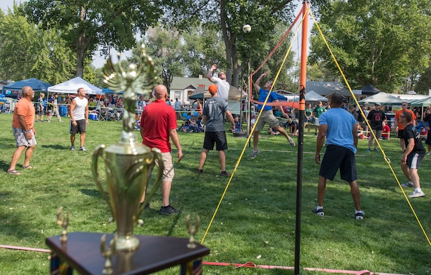 Members of Mountain Home Air Force Base, Idaho take part in a volleyball tournament during Air Force Appreciation Day in Mountain Home, Idaho, Sept.12, 2015. One of the four Air Force teams won the tournament. (U.S. Air Force photo by Airman Chester Mientkiewicz)