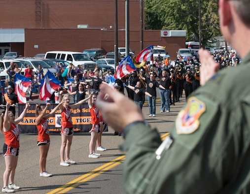 Col. Andrew Moore, 366th Medical Group commander, applauds the Mountain Home Tigers Cheerleading Team at the annual Air Force Appreciation Day parade in Mountain Home, Idaho, Sept. 12, 2015. The parade is held to display the relationship between nearby Mountain Home Air Force Base and the city. (U.S. Air Force photo by Airman Chester Mientkiewicz)
