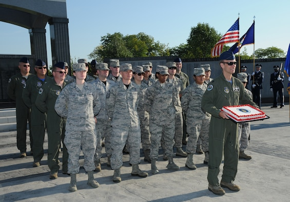 Members of the 914th Airlift Wing conduct a ceremony honoring the United States Air Force's 68th birthday on Friday, September 18, 2015, at Hyde Park in Niagara Falls. The Niagara Falls Veterans Memorial Monument Commission hosted a celebration of the USAF birthday by striking colors and re-raising them with the USAF flag, which will fly for one week in honor of our flying force.  (U.S. Air Force photo by Staff Sgt. Matthew Burke)
