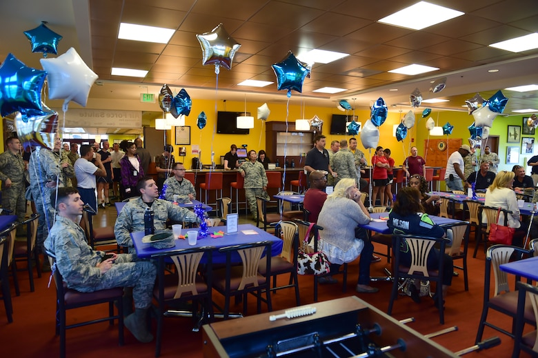 Team Buckley members gather at the Panther Den to celebrate the Air Force birthday Sept. 18, 2015, on Buckley Air Force Base, Colo. The Air Force turns 68 this year and continues to fly, fight and win in air, space and cyberspace. (U.S. Air Force photo by Airman 1st Class Luke W. Nowakowski/Released)