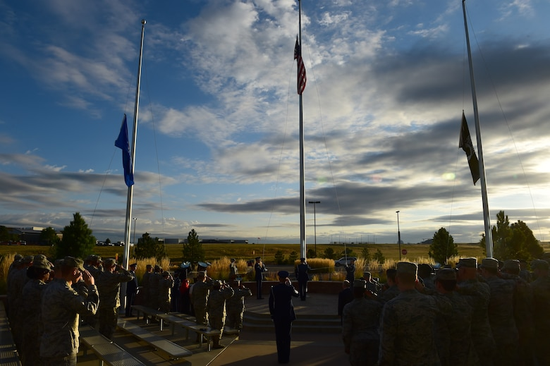 The Prisoner of War/Missing in Action flag was raised in the place of the American flag during a ceremony Sept. 18, 2015, on Buckley Air Force Base, Colo. The ceremony recognized those who have had to endure enemy captivity and those who never made it back home after a conflict. The guest of honor retired Tech. Sgt. Jasper Page, was a POW during the Vietnam War but escaped captivity and was able to make it back to American positions safely. (U.S. Air Force photo by Airman 1st Class Luke W. Nowakowski/Released)