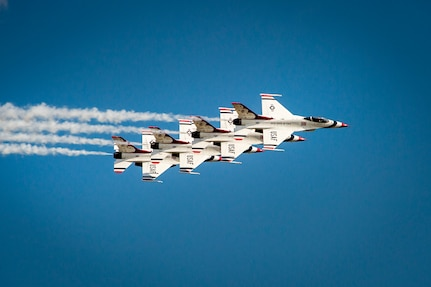 U.S. Air Force Thunderbirds perform during the rehearsal day prior to the 2015 Andrews Air Show at Joint Base Andrews, Md., Sept. 18, 2015. The Thunderbirds will be the headlining performers for the 2015 AAS on Sept. 19, 2015. (U.S. Air Force photo/Airman 1st Class Ryan J. Sonnier)