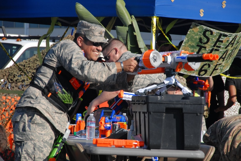 """In deference to severe drought conditions in California, NERF weaponry of various sizes, shapes, and firepower were creatively pressed into action in lieu of water guns or balloons for mock """"Code Red"""" attacks on the encampment during the Space and Missile Systems Center Dining-Out at Los Angeles Air Force Base in El Segundo, Calif. (U.S. Air Force photo/Jim Spellman)"""