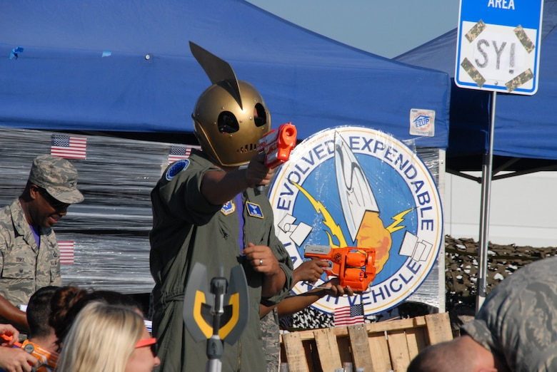 """""""The Rocketeer"""" time-warps in from the 1940s to help defend the Space and Missile Systems Center's Evolved Expendable Launch Vehicle tent during a mock """"Code Red"""" firefight at the SMC Dining Out at Los Angeles Air Force Base in El Segundo, Calif. (U.S. Air Force photo/Jim Spellman)"""