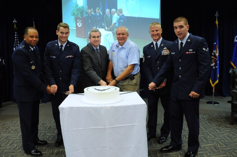 From left to right: Lt. Gen. Samuel Greaves, SMC commander and Air Force Program Executive Officer for Space, 2nd Lt. Noah Pierce, SMC's most junior officer, Mr. Thomas Fitzgerald, acting SMC executive director, Mr. Cory Etchberger, son of Medal of Honor recipient Chief Master Sgt. Richard Etchberger, Chief Master Sgt. Craig Hall, SMC Command Chief, and Airman 1st Class Anthony Gladsky, SMC's most junior enlisted service member, cut a ceremonial cake to mark the celebration of the U.S. Air Force's 68th Birthday Sept. 18 in the Schriever Space Complex's Gordon Conference Center at Los Angeles Air Force Base in El Segundo, Calif. (U.S. Air Force photo/Van De Ha)