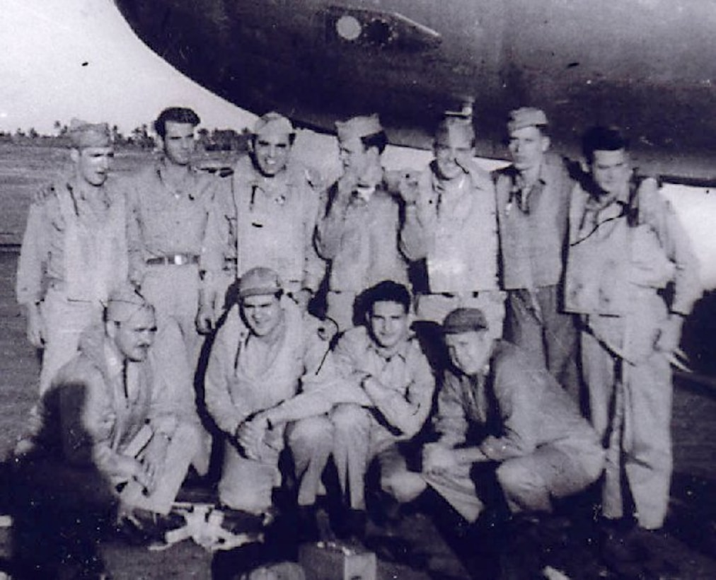 """Original members of Crew # 2416 are shown in this wartime picture.  Most were aboard the 24th Bomb Squadron B-29 Superfortress """"Sharon Linn,"""" when it was shot down on the night of 19 July 1945 while on a minelaying mission to Niigata, Japan.    Standing, left to right, are S/Sgt Florio D. Spero (Tail Gunner), M/Sgt George E. McGraw (Engineer) [POW], S/Sgt Norman S. Kruvant (CFC Gunner) [not on last flight], Sgt. Robert A. Grant (Left Gunner), S/Sgt Max A. Adams (Radar), S/Sgt Robert J. Burkle (Right Gunner), S/Sgt Walter W. Wiernik (Radio) [POW].  Kneeling, left to right, are Capt. Gordon P. Jordan (Aircraft Commander) [POW], 1st Lt. Wails Hawkins (Pilot), 1st Lt. Milton Garin (Navigator) [not on last flight], 1st Lt. Clinton L. Wride (Bombardier).    Crewmembers on last flight who are not shown here are 2nd Lt. Paul A. Trump (Navigator) [POW] and S/Sgt Walter W. Dickerson (Central Fire Control (CFC) Gunner) [POW].  (Courtesy 6th Bomb Group Association)"""