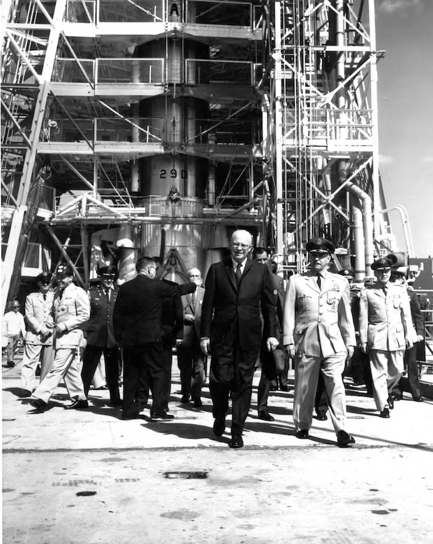 President Dwight D. Eisenhower visits the Eastern Test Range at Cape Canaveral, Fla. in 1960 as the Atlas D29 is being prepared for launch of MIDAS 1, part of the Weapon System 117L. The MIDAS program aimed at developing a satellite that would carry an infrared sensor to detect hostile ICBM launches. Although the first MIDAS satellite failed to achieve orbit in February 1960, a MIDAS satellite under a subsequent test program AFP461 was successfully launched on May 9, 1963. It operated long enough to detect nine missile launches, thereby contributing to the series of test flights which served to demonstrate the system's increasing reliability and longevity. (U.S. Air Force photo)