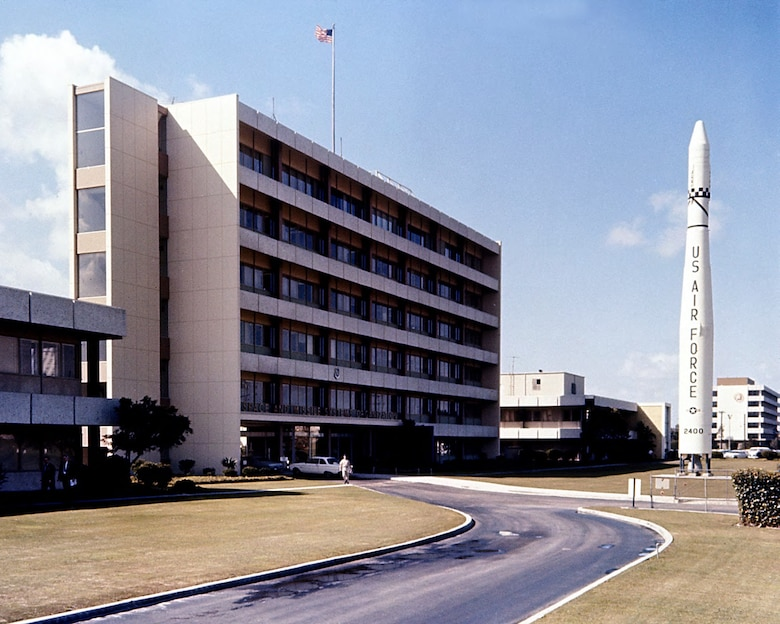 The Thor-Agena monument stands in front of Bldg. 105, headquarters of Space Systems Division in Area A of Los Angeles Air Force Station in February 1967. (U.S. Air Force photo)