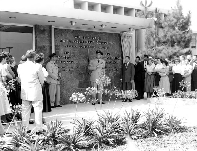 Then-Maj..Gen. Bernard Schriever presides over the new Western Development Division facility on Arbor Vitae Blvd. in Inglewood, Calif. in 1956. Dr. Simon Ramo of the Ramo-Wooldridge Corporation is to Gen. Schriever's left. (U.S. Air Force photo)