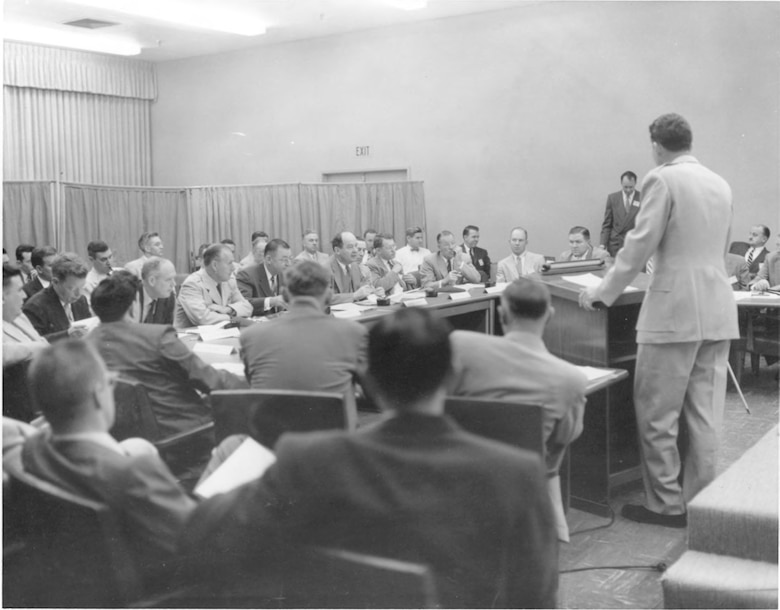 Then-Brig. Gen. Bernard Schriever address a session of the Von Neumann Committee at the Western Development Division's Arbor Vitae Complex in Inglewood, Calif. in the fall of 1955. The Committee had been reconstituted as the Atlas Scientific Advisory Committee. Facing Gen. Schriever in the front row (left to right) are George McRae of Sandia Corporation, aviation legend Charles Lindbergh, Gen. Thomas Power, commander of the Air Research and Development Command, Assistant Secretary of the Air Force Trevor Gardner, Committee Chairman John von Neumann, Col. Harold Norton, H. Guyford Stever of MIT and Clark Millikan of Caltech (U.S. Air Force photo)