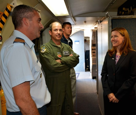 "Canadian Consul General Sara Wilshaw, right, receives a tour of an E-3 ""Sentry"" Airborne Warning and Control System aircraft by Lt. Col. Donald Saunders, 552nd Air Control Wing Canadian Detachment commander, left, and Col. David Gaedecke, 552nd ACW commander, shortly after her arrival to the base here Monday afternoon. During her brief visit, Ms. Wilshaw also presented the Canadian Forces Decoration for longevity to Maj. Mike Wiseman and Capt. Jennifer Campbell, and participated in a roundtable discussion with about 30 members of the Canadian Detachment. The decoration is awarded to members of the Canadian Forces who have completed 12 years of service. Ms. Wilshaw serves as the Consul General of Canada to the South Central United States, which is based in Dallas and consists of Arkansas, Louisiana, New Mexico, Oklahoma and Texas. In a message from the Consul General, Ms. Wilshaw said, ""We defend North America together. At Tinker Air Force Base, 43 members of the Royal Canadian Air Force and Canadian Army form the Canadian Component. For 35 years, Canadians have been an integral part of the North American Aerospace Defense Command's [AWACS] program, deploying in North American skies and around the globe. And, we're building North America's energy security together."" (Air Force photo by Darren D. Heusel/Released)"