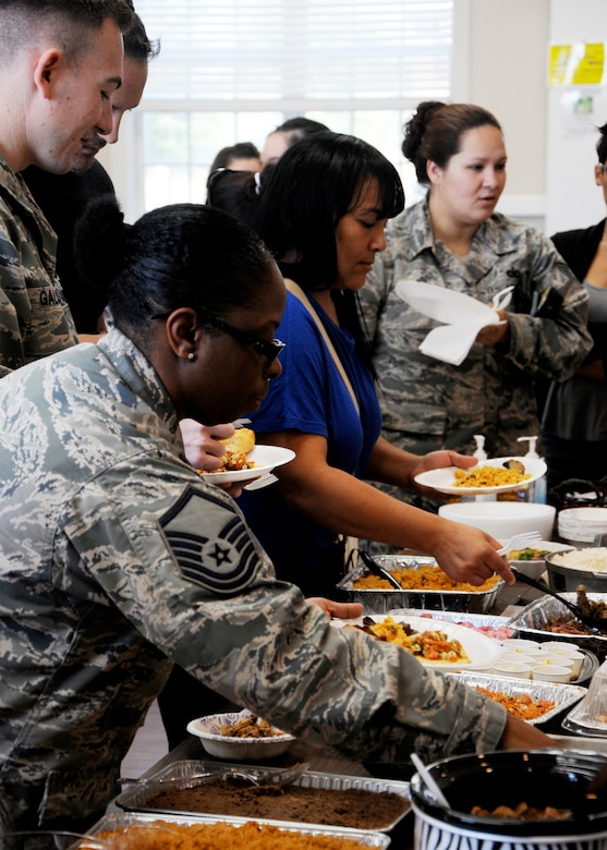 Members of Columbus Air Force Base participate in the Hispanic Heritage Month Cook Off Sept. 16 at the Chapel Annex on the base in Mississippi. The base community was encouraged to bring a dish to be entered into the cook off. Prizes were awarded for 1st, 2nd and 3rd place dishes. (U.S. Air Force Photo/Melissa Doublin)