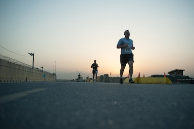 U.S. Service members run during the Air Force Half Marathon event at BAF, Afghanistan, Sept. 19, 2015. This year marked the 7th year that the AF has sanctioned deployed location races overseas. (U.S. Air Force photo by Tech. Sgt. Joseph Swafford/Released)