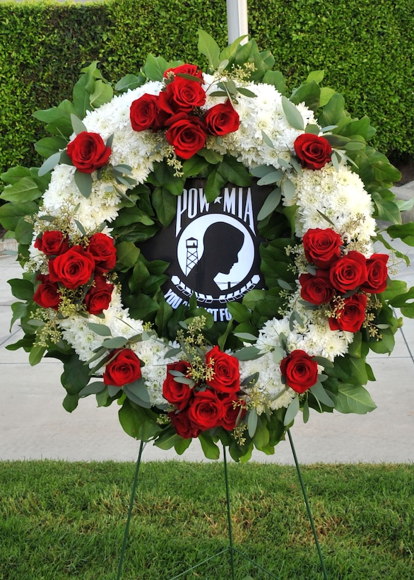 A commemorative POW/MIA wreath stands in repose awaiting the start of the National POW/MIA Recognition Day at the Space and Missile Systems Center's Schriever Space Complex flagpole at Los Angeles Air Force Base in El Segundo, Calif. (U.S. Air Force photo/Sarah Corrice)
