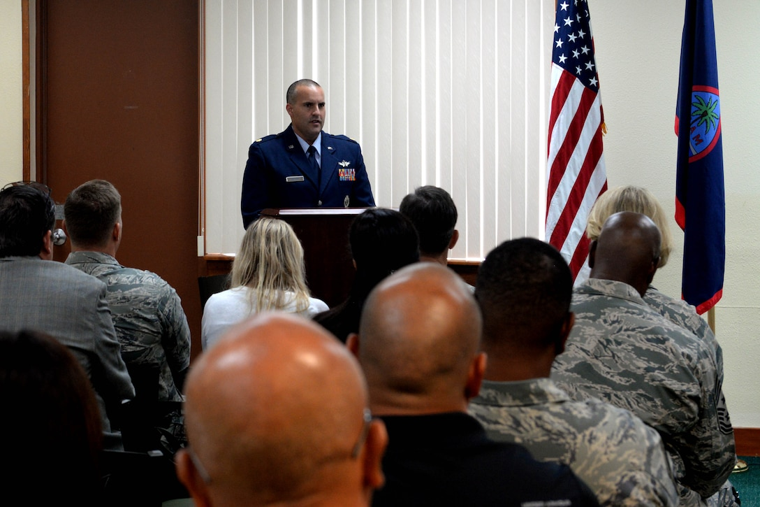 Maj. Christopher Butler, 21st Space Operations Squadron Detachment 2 commander, speaks to an audience Sept. 17, 2015 at Northwest Field on Andersen Air Force Base, Guam. The 21st SOPS Det 2 celebrated their 50th anniversary with a ceremony here Sept. 17, 2015. (U.S. Air Force photo by Airman 1st Class Alexa Ann Henderson/Released)