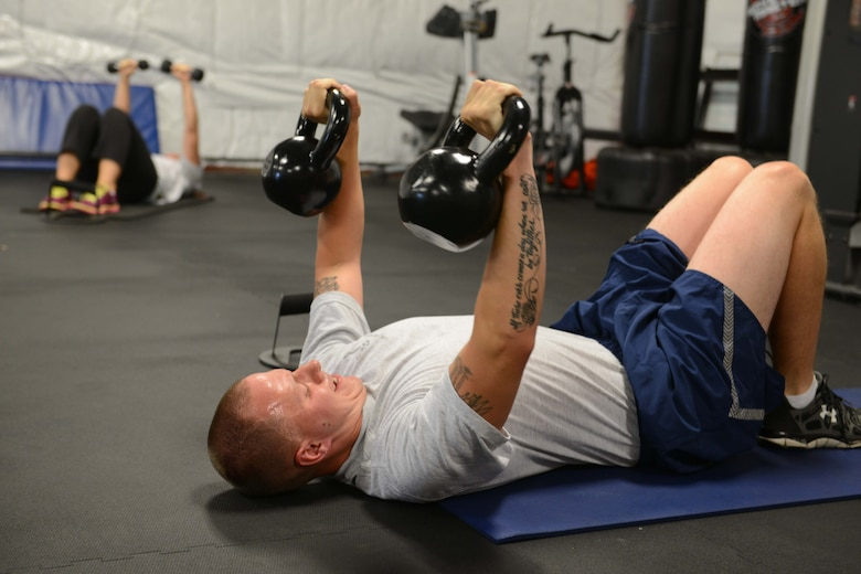 A physical fitnessl training class is held at the base gym during drill weekend at 132d Wing on Sunday, August 2, 2015. 2nd   (U.S. Air National Guard photo by Tech. Sgt. Michael B. McGhee/Released)