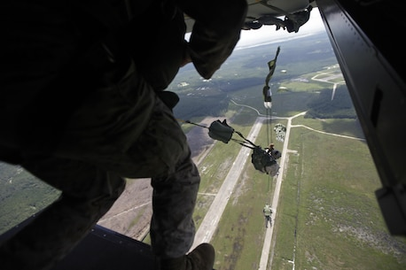 U.S. Marines with Marine Raider Regiment, conduct a static-line jump from an MV-22B Osprey assigned to Marine Medium Tiltrotor Squadron 265 (VMM), during parachute exercises above drop zone Pheasant, N.C., Sept. 1, 2015. VMM-365 transported Marines assigned to Marine Raider Regiment as they conducted the exercises.