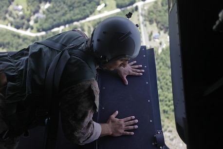 U.S. Marine Corps Sgt. Melvin Rodas, an airborne and air delivery specialist with Marine Raider Regiment, looks for a drop marker from the back of an MV-22B Osprey during parachute exercises above drop zone Pheasant, N.C., Sept. 1, 2015. VMM-365 transported Marines assigned to Marine Raider Regiment as they conducted the exercises.