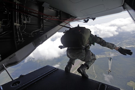 A U.S. Marine with Marine Raider Regiment, conducts a free-fall jump from the back of an MV-22B Osprey assigned to Marine Medium Tiltrotor Squadron 265 (VMM), during parachute exercises above drop zone Pheasant, N.C., Sept. 1, 2015. VMM-365 transported Marines assigned to Marine Raider Regiment as they conducted the exercises.