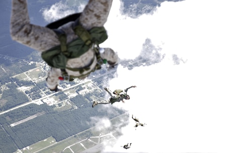 U.S. Marines with Marine Raider Regiment, conduct a free-fall jump from the back of an MV-22B Osprey assigned to Marine Medium Tiltrotor Squadron 265 (VMM), during parachute exercises above drop zone Pheasant, N.C., Sept. 1, 2015. VMM-365 transported Marines assigned to Marine Raider Regiment as they conducted the exercises.