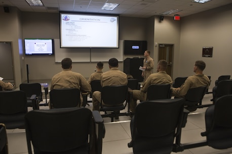 U.S. Marine Corps Capt. Edward C. Proulx, an MV-22B Osprey pilot with Marine Medium Tiltrotor Squadron (VMM) 365, delivers a brief on Marine Corps Air Station New River, N.C., Sept. 2, 2015. VMM-365 supported Marine Corps Security Force Regiment, Fleet Antiterrorism Security Team Company, Fifth Platoon, by providing a means of quickly evacuating simulated casualties during a casualty evacuation drill.